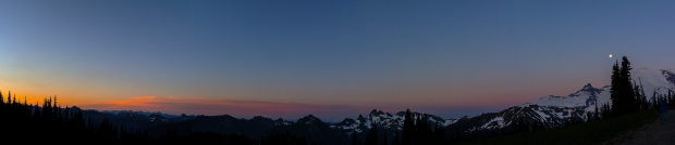 Panoramic of the sun rising and the moon setting.